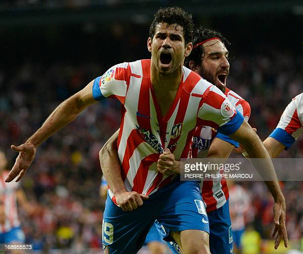 Atletico Madrid's Brazilian forward Diego da Silva Costa celebrates with his teammate Turkish midfielder Arda Turan after scoring during the Spanish...