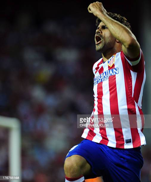 Atletico Madrid's Brazilian forward Diego da Silva Costa celebrates after scoring against Sevilla during the Spanish league football match Sevilla FC...