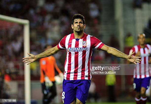 Atletico Madrid's Brazilian forward Diego da Silva Costa celebrates after scoring against Sevilla during the Spanish league football match Sevilla FC...