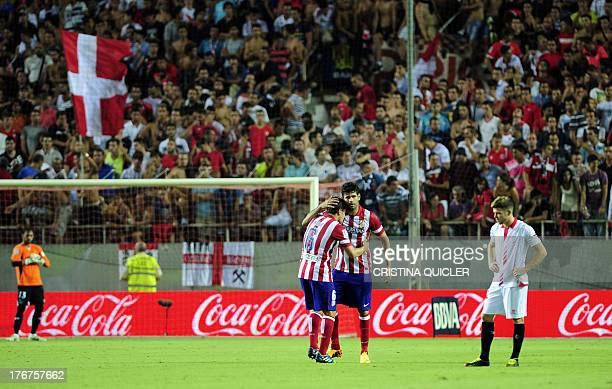 Atletico Madrid's Brazilian forward Diego da Silva Costa celebrates after scoring with Atletico Madrid's midfielder Koke during the Spanish league...