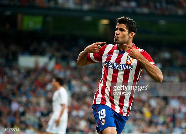 Atletico Madrid's Brazilian forward Diego da Silva Costa celebrates after scoring during the Spanish league football match Real Madrid CF vs Club...