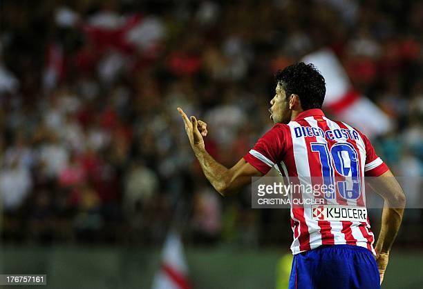 Atletico Madrid's Brazilian forward Diego da Silva Costa reacts to play during the Spanish league football match Sevilla FC vs Club Atletico de...