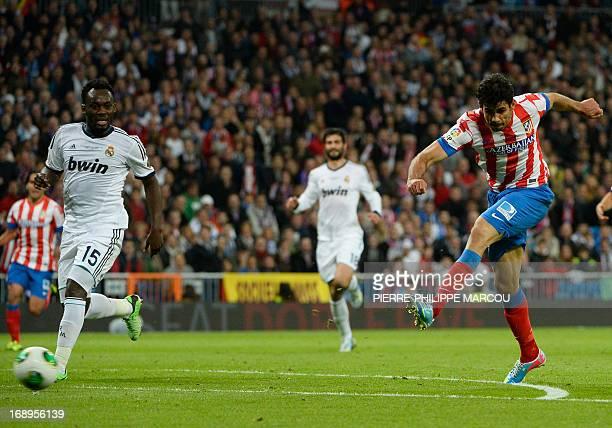 Atletico Madrid's Brazilian forward Diego da Silva Costa scores during the Spanish King's Cup final football match Real Madrid vs Atletico de Madrid...