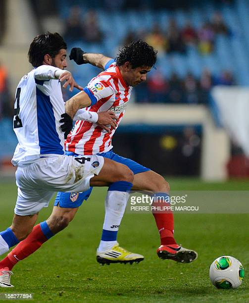 Atletico Madrid's Brazilian forward Diego da Silva Costa vies with Getafe's defender Miguel Torres during the Spanish Cup football match Atletico de...