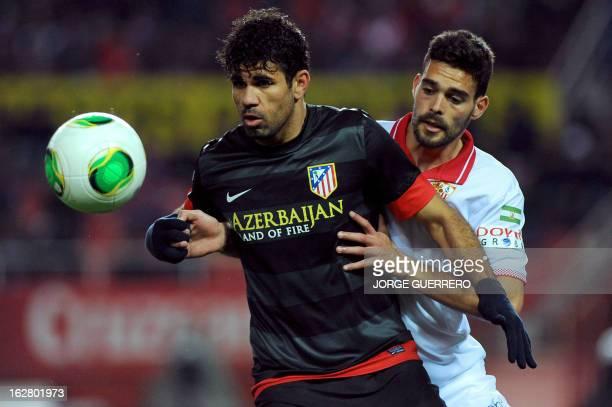 Atletico Madrid's Brazilian forward Diego da Silva Costa vies with Sevilla's defender Tomas Alberto Botia during the Copa del Rey semifinal second...