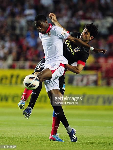 Atletico Madrid's Brazilian forward Diego da Silva Costa vies with Sevilla's French midfielder Geoffrey Kondogbia during the Spanish league football...