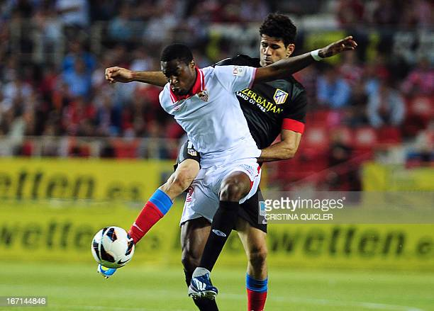 Atletico Madrid's Brazilian forward Diego da Silva Costa vies with Sevilla's French midfielder Geoffrey Kondogbia during the Spanish league football...