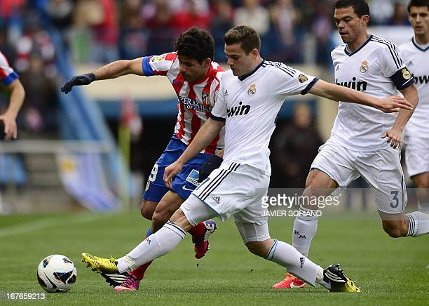 Atletico Madrid's Brazilian forward Diego da Silva Costa vies with Real Madrid's forward Alvaro Morata during the Spanish league football match Club...