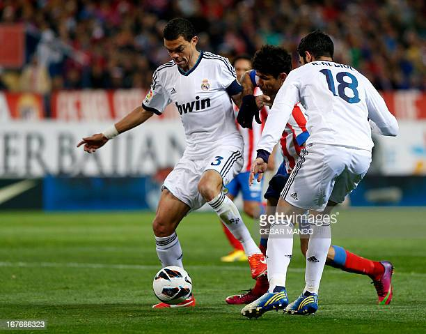 Atletico Madrid's Brazilian forward Diego da Silva Costa vies with Real Madrid's Portuguese defender Pepe during the Spanish league football match...