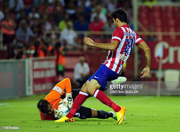 Atletico Madrid's Brazilian forward Diego da Silva Costa vies with Sevilla's Portuguses goalkeeper Beto during the Spanish league football match...