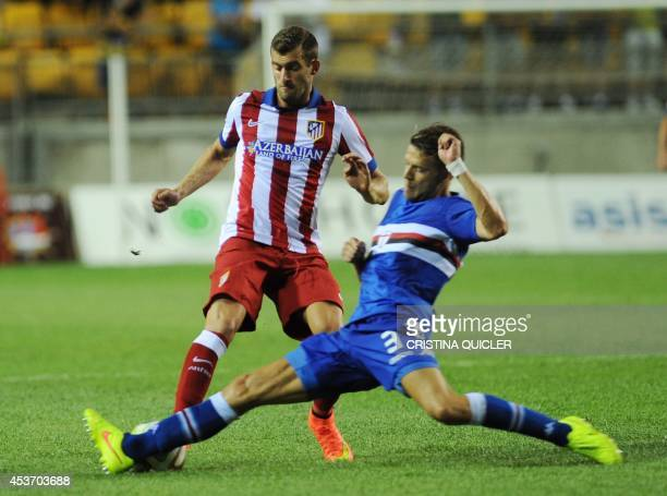 Atletico Madrid's Brazilian forward Leo Baptistao vies with Sampdoria's Italian defender Andrea Costa during the Trofeo Carranza football match...