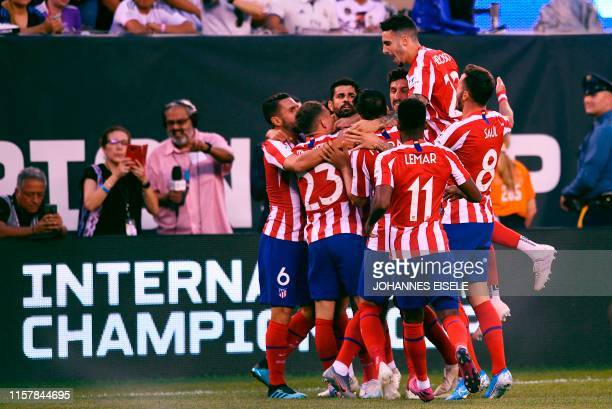 Atletico Madrid's Brazilian foward Diego Costa celebrates with teammates after scoring during their 2019 International Champions Cup football match...