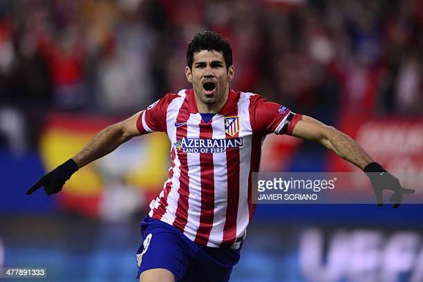 Atletico Madrid's Brazilianborn forward Diego da Silva Costa celebrates after scoring their first goal during the UEFA Champions League quarterfinal...
