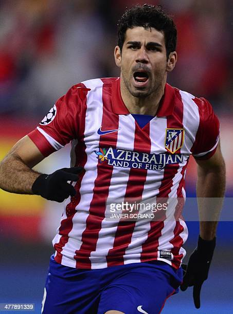 Atletico Madrid's Brazilianborn forward Diego da Silva Costa celebrates after scoring their first goal during the UEFA Champions League quarterfinal...