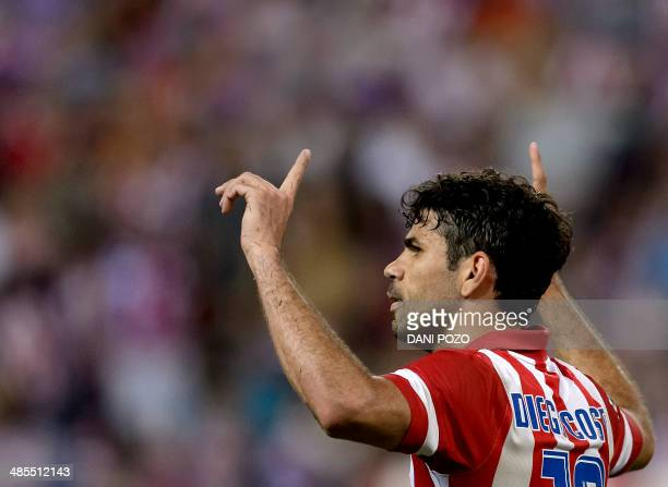 Atletico Madrid's Brazilianborn forward Diego da Silva Costa celebrates after scoring during the Spanish league football match Club Atletico de...