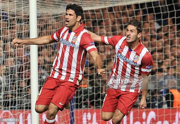 Atletico Madrid's Brazilianborn forward Diego da Silva Costa celebrates scoring his team's second goal with Atletico Madrid's Spanish midfielder Koke...