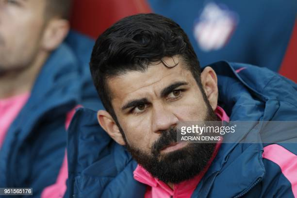 Atletico Madrid's Brazilianborn Spanish striker Diego Costa looks on from the bench before the UEFA Europa League first leg semifinal football match...