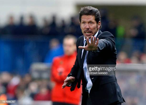 Atletico Madrid's coach Diego Simeone reacts during the Spanish league football match Club Atletico de Madrid vs Real Madrid CF at the Vicente...