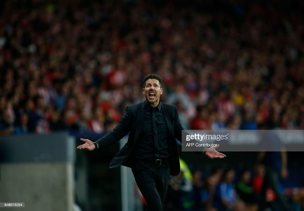 Atletico Madrid's coach from Argentina Diego Simeone reacts during the Spanish league football match Club Atletico de Madrid vs Malaga CF at the Wanda Metropolitano stadium in Madrid on September 16, 2017. /