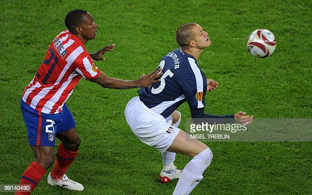 Atletico Madrid's Colombian defender Luis Perea and Fulham's English striker Bobby Zamora vie for the ball during the final football match of the...