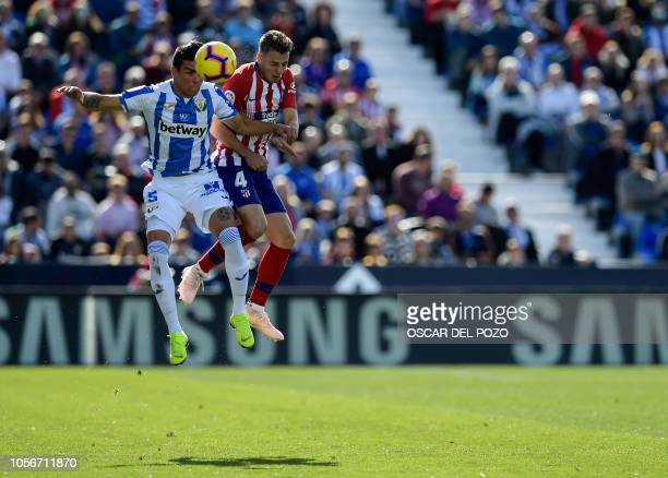 TOPSHOT Atletico Madrid's Colombian defender Santiago Arias vies with Leganes' Argentinian defender Jonathan Silva during the Spanish league football...
