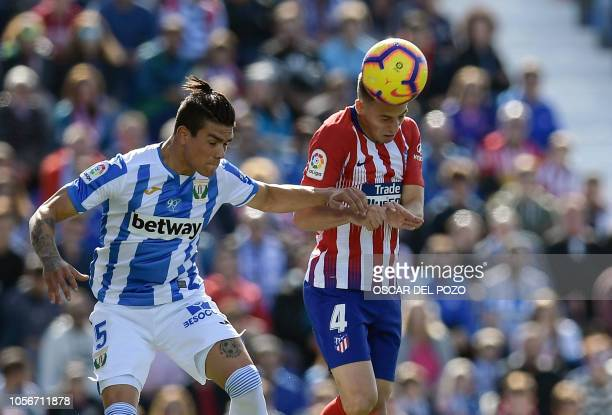 Atletico Madrid's Colombian defender Santiago Arias vies with Leganes' Argentinian defender Jonathan Silva during the Spanish league football match...