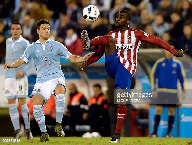 Atletico Madrid's Colombian forward Jackson Martinez vies with Celta Vigo's Serbian midfielder Nemanja Radoja during the Spanish Copa del Rey...