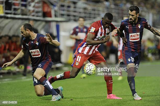 Atletico Madrid's Colombian forward Jackson Martinez vies with Eibar's defender Antonio Luna during the Spanish league football match SD Eibar vs...