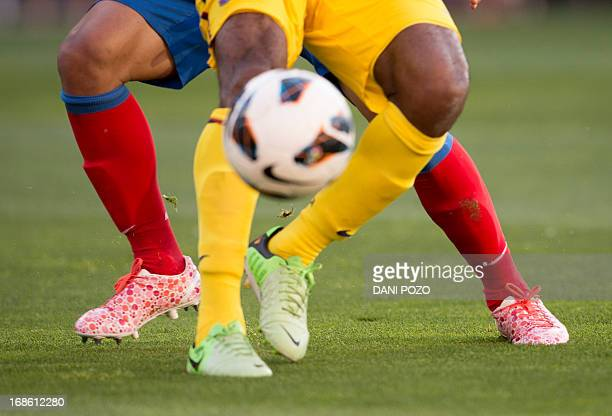 Atletico Madrid's Colombian forward Radamel Falcao Garcia vies with Barcelona's Cameroonian midfielder Alex Song during the Spanish League football...