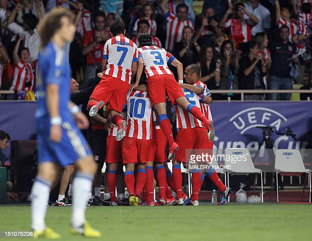 Atletico Madrid's Colombian forward Radamel Falcao is congratulated by his teammates after scoring a goal during the UEFA Super Cup football match...