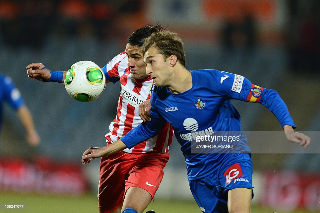 Atletico Madrid's Colombian forward Radamel Falcao (L) vies with Getafe's defender Rafael Lopez (R) during the Spanish Copa del Rey (King's Cup) round of 16, second leg, football match Getafe vs Atletico de Madrid at the Coliseum Alfonso Perez stadium on January 10, 2013.