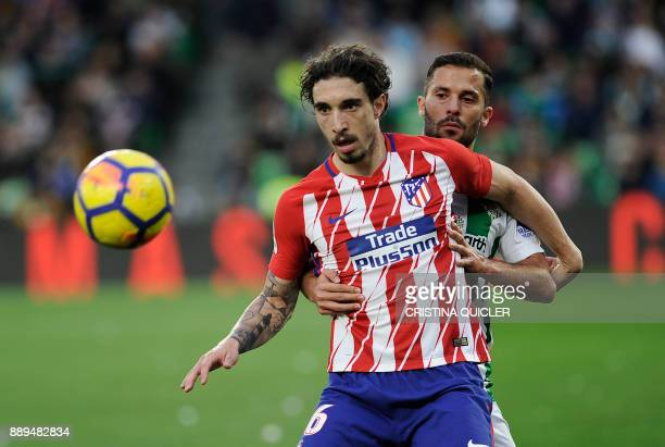 Atletico Madrid's Croatian defender Sime Vrsaljko challenges Real Betis' Danish defender Riza Durmisi during the Spanish league football match...