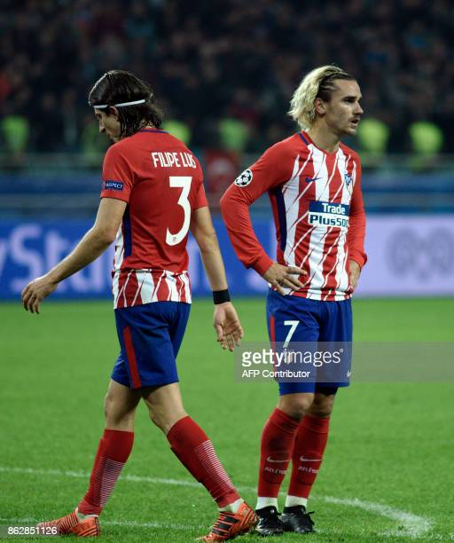 Atletico Madrid's defender from Brazil Filipe Luis and Atletico Madrid's forward from France Antoine Griezmann react during the UEFA Champions League...