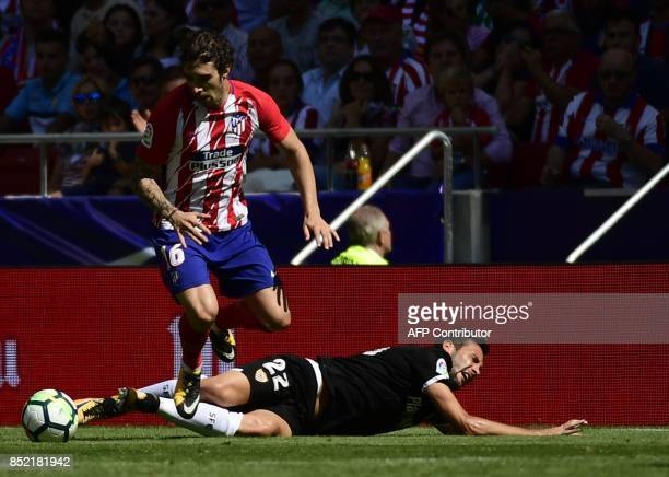 Atletico Madrid's defender from Croatia Sime Vrsaljko vies with Sevilla's midfielder from Italy Franco Vazquez during the Spanish league football...