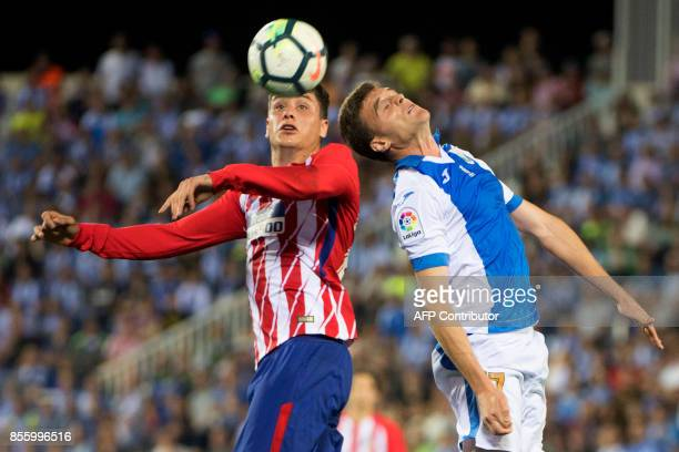 Atletico Madrid's defender from Uruguay Jose Maria Gimenez vies with LeganesÕ midfielder from Spain Javier Eraso Goni during the Spanish league...