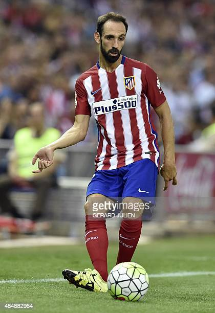 Atletico Madrid's defender Juanfran passes a ball during the Spanish league football match Club Atletico de Madrid vs UD Las Palmas at the Vicente...