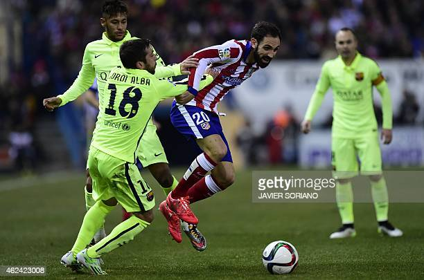Atletico Madrid's defender Juanfran vies with Barcelona's defender Jordi Alba and Barcelona's Brazilian forward Neymar da Silva Santos Junior during...