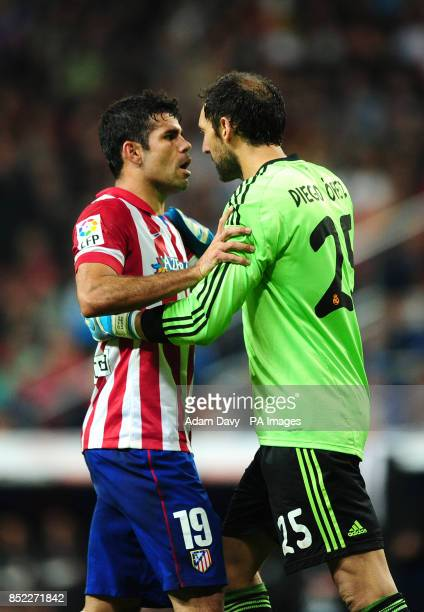 Atletico Madrid's Diego Costa argues with Real Madrid goalkeeper Diego Lopez