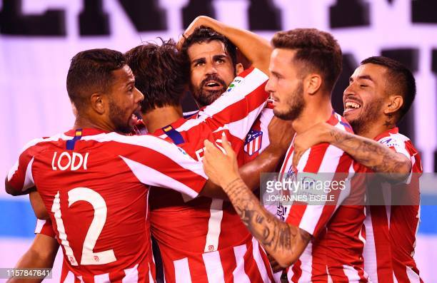 Atletico Madrid's Diego Costa celebrates with teammates after scoring a second goal during the 2019 International Champions Cup football match...