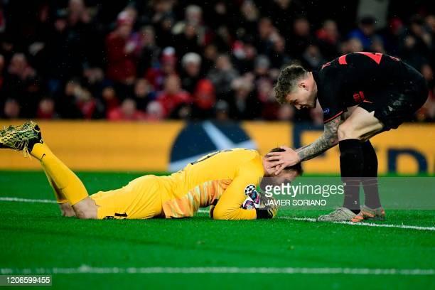 Atletico Madrid's English defender Kieran Trippier gestures to Atletico Madrid's Slovenian goalkeeper Jan Oblak during the UEFA Champions league...