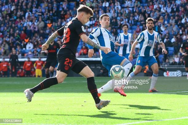 Atletico Madrid's English defender Kieran Trippier vies with Espanyol's Spanish midfielder Esteban Granero during the Spanish League football match...