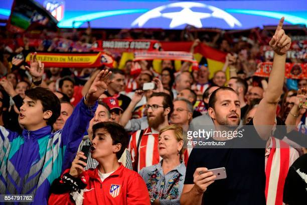 Atletico Madrid's fan cheer their team before the UEFA Champions League Group C football match Club Atletico de Madrid vs Chelsea FC at the...