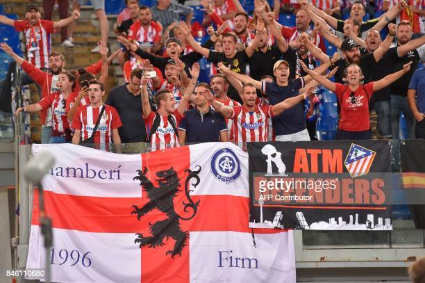 Atletico Madrid's fans cheer prior to the UEFA Champions League Group C football match between AS Roma and Atletico Madrid on September 12 2017 at...