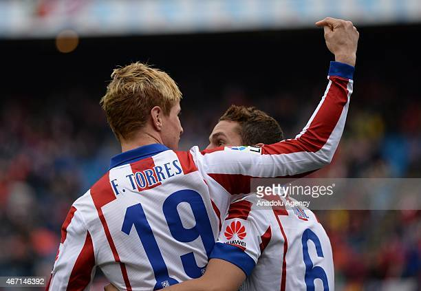 Atletico Madrid's Fernando Torres celebrates with his teammate Koke after scoring a goal during the Spanish La Liga football match between Atletico...
