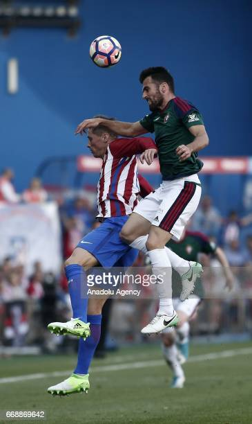 Atletico Madrid's Fernando Torres is in action against CA Osasuna's Juan Fuentes during the Spanish soccer league La Liga football match Atletico de...