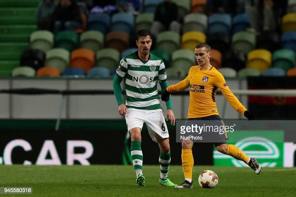 Atletico Madrids forward Antoine Griezmann of France vies with Sporting's defender Andre Pinto from Portugal during the UEFA Europa League second leg...