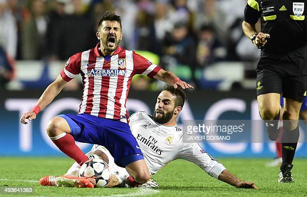 Atletico Madrid's forward David Villa vies with Real Madrid's defender Daniel Carvajal during the UEFA Champions League Final Real Madrid vs Atletico...