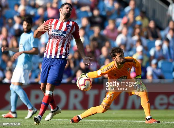 Atletico Madrid's forward Diego Costa reacts after his shot on goal was saved by Celta Vigo's Spanish goalkeeper Sergio Alvarez during the Spanish...