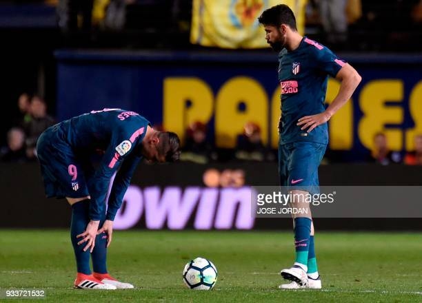 Atletico Madrid's forward Fernando Torres and Atletico Madrid's Spanish forward Diego Costa wait for resuming the game during the Spanish League...