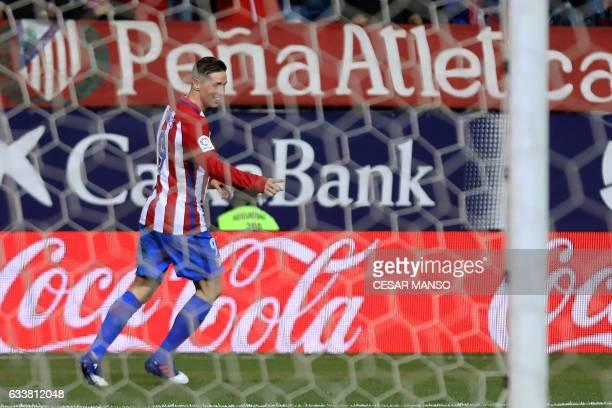 Atletico Madrid's forward Fernando Torres celebrates a goal during the Spanish league football match Club Atletico de Madrid vs Club Deportivo...